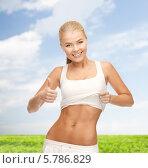 Купить «Стройная девушка показывает свое красивое тело», фото № 5786829, снято 23 марта 2013 г. (c) Syda Productions / Фотобанк Лори