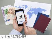 Купить «Покупка авиабилетов через мобильное приложение для смартфона», фото № 5793497, снято 5 января 2014 г. (c) Андрей Попов / Фотобанк Лори