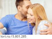 Купить «Счастливая влюбленная пара. Девушка улыбается, случая что мужчина говорит ей на ухо», фото № 5801285, снято 9 февраля 2014 г. (c) Syda Productions / Фотобанк Лори