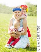 Купить «Счастливая женщина с двумя детьми в национальной одежде», фото № 5817757, снято 15 июня 2013 г. (c) Яков Филимонов / Фотобанк Лори