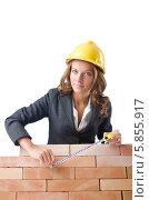 Купить «Женщина-строитель с рулеткой», фото № 5855917, снято 27 июля 2012 г. (c) Elnur / Фотобанк Лори