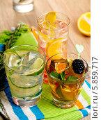 Купить «Три стакана с разноцветными фруктовыми коктейлями и кубиками льда», фото № 5859717, снято 16 февраля 2014 г. (c) Алексей Лысенко / Фотобанк Лори