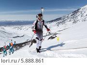 Купить «Ски-альпинисты поднимаются на вулкан. Соревнования по ски-альпинизму, индивидуальная гонка», фото № 5888861, снято 26 апреля 2014 г. (c) А. А. Пирагис / Фотобанк Лори