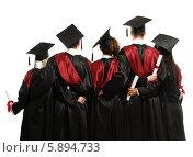 Купить «Группа выпускников, стоящих спиной, в мантиях и академических шапочках», фото № 5894733, снято 24 апреля 2014 г. (c) Andrejs Pidjass / Фотобанк Лори
