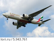 Купить «Boeing 777 (бортовой A6-EFL) авиакомпании Emirates на посадке в Домодедове», эксклюзивное фото № 5943761, снято 25 мая 2014 г. (c) Alexei Tavix / Фотобанк Лори