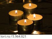 Купить «Четыре чайных свечи», фото № 5964821, снято 22 января 2014 г. (c) Anton Kozyrev / Фотобанк Лори