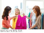 Купить «Три подруги выбирают платье в магазине», фото № 5972721, снято 12 апреля 2014 г. (c) Syda Productions / Фотобанк Лори