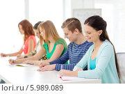 Купить «Учащиеся что-то записывают в тетради, сидя на лекции в аудитории», фото № 5989089, снято 4 мая 2014 г. (c) Syda Productions / Фотобанк Лори