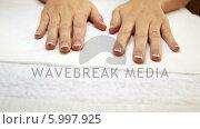Купить «Hands showing fresh french manicure», видеоролик № 5997925, снято 19 июня 2019 г. (c) Wavebreak Media / Фотобанк Лори