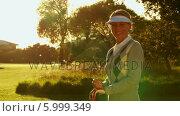 Happy woman smiling at camera on the golf course. Стоковое видео, агентство Wavebreak Media / Фотобанк Лори