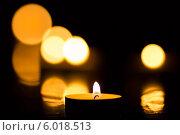 Купить «Свеча горящая с боке», фото № 6018513, снято 22 января 2014 г. (c) Anton Kozyrev / Фотобанк Лори