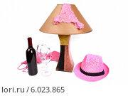 Женские розовые трусики на ночной лампе. Рядом бутылка вина и два бокала. Стоковое фото, фотограф Владимир Ходатаев / Фотобанк Лори