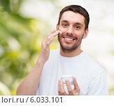 Купить «beautiful smiling man applyin cream», фото № 6033101, снято 15 марта 2014 г. (c) Syda Productions / Фотобанк Лори