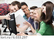 Купить «students looking at computer monitor at school», фото № 6033297, снято 16 июня 2013 г. (c) Syda Productions / Фотобанк Лори