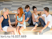Students talking sitting on school bench. Стоковое фото, фотограф CandyBox Images / Фотобанк Лори