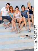 Happy college students sitting on stairs summer. Стоковое фото, фотограф CandyBox Images / Фотобанк Лори