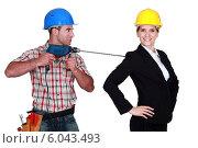 Купить «craftsman threatening his boss with a drill», фото № 6043493, снято 29 марта 2011 г. (c) Phovoir Images / Фотобанк Лори