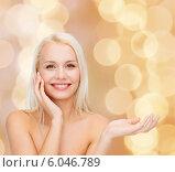 Купить «smiling woman holding imaginary lotion jar», фото № 6046789, снято 15 апреля 2014 г. (c) Syda Productions / Фотобанк Лори