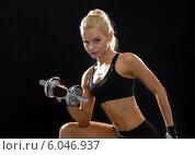 Купить «young sporty woman with heavy steel dumbbell», фото № 6046937, снято 8 мая 2014 г. (c) Syda Productions / Фотобанк Лори