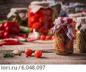 Купить «Preserved and fresh vegetables on wooden background», фото № 6048097, снято 5 апреля 2014 г. (c) Майя Крученкова / Фотобанк Лори