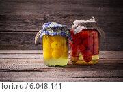 Купить «Vegetable preserves on wooden background», фото № 6048141, снято 5 апреля 2014 г. (c) Майя Крученкова / Фотобанк Лори
