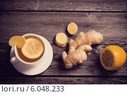 Ginger tea with lemon in a white cup. Стоковое фото, фотограф Майя Крученкова / Фотобанк Лори