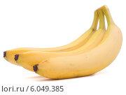 Купить «Bananas bunch isolated on white background cutout», фото № 6049385, снято 19 марта 2013 г. (c) Natalja Stotika / Фотобанк Лори