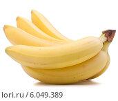 Купить «Bananas bunch isolated on white background cutout», фото № 6049389, снято 22 марта 2013 г. (c) Natalja Stotika / Фотобанк Лори