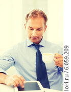 Купить «businessman with tablet pc and coffee in office», фото № 6059209, снято 9 июня 2013 г. (c) Syda Productions / Фотобанк Лори