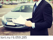 Купить «man with car documents outside», фото № 6059285, снято 26 июня 2013 г. (c) Syda Productions / Фотобанк Лори
