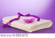 Купить «Орхидея на полотенце», фото № 6059673, снято 3 апреля 2013 г. (c) Сергей Молодиков / Фотобанк Лори