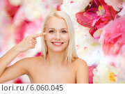 Купить «beautiful woman touching her eye area», фото № 6060045, снято 15 апреля 2014 г. (c) Syda Productions / Фотобанк Лори