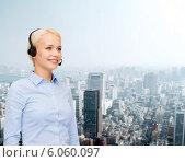 Купить «friendly female helpline operator with headphones», фото № 6060097, снято 15 апреля 2014 г. (c) Syda Productions / Фотобанк Лори