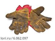 Две грязные перчатки на белом фоне. Стоковое фото, фотограф Федорец Артем / Фотобанк Лори