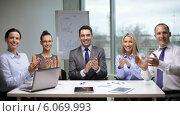 Купить «Business people applauding on meeting», видеоролик № 6069993, снято 12 ноября 2013 г. (c) Syda Productions / Фотобанк Лори