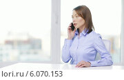 Купить «Busy businesswoman with smartphone in office», видеоролик № 6070153, снято 1 января 2014 г. (c) Syda Productions / Фотобанк Лори