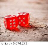 Купить «Pair of thrown red dices on old wooden table», фото № 6074273, снято 10 марта 2014 г. (c) Майя Крученкова / Фотобанк Лори