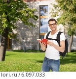 Купить «travelling student with backpack and book», фото № 6097033, снято 8 апреля 2012 г. (c) Syda Productions / Фотобанк Лори