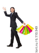 Купить «Man with shopping bags isolated on white», фото № 6110949, снято 7 июня 2014 г. (c) Elnur / Фотобанк Лори
