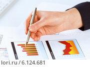 Купить «Analyzing report», фото № 6124681, снято 15 января 2014 г. (c) Sergey Nivens / Фотобанк Лори