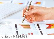 Купить «Analyzing report», фото № 6124689, снято 15 января 2014 г. (c) Sergey Nivens / Фотобанк Лори