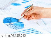 Купить «Analyzing report», фото № 6125013, снято 15 января 2014 г. (c) Sergey Nivens / Фотобанк Лори