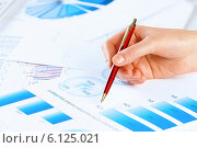 Купить «Analyzing report», фото № 6125021, снято 15 января 2014 г. (c) Sergey Nivens / Фотобанк Лори