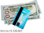 Кредитка и доллары на белом фоне. Стоковое фото, фотограф Левончук Юрий / Фотобанк Лори