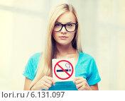 Купить «woman with smoking restriction sign», фото № 6131097, снято 30 марта 2013 г. (c) Syda Productions / Фотобанк Лори