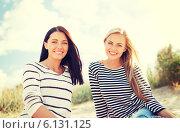 Купить «smiling girlfriends having fun on the beach», фото № 6131125, снято 31 августа 2013 г. (c) Syda Productions / Фотобанк Лори