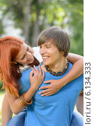 Купить «Loving couple piggyback hugging in sunny park», фото № 6134333, снято 19 июня 2014 г. (c) CandyBox Images / Фотобанк Лори