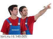 Купить «Decorator pointing into distance», фото № 6149005, снято 31 января 2011 г. (c) Phovoir Images / Фотобанк Лори