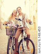 Купить «couple with bicycles in the city», фото № 6149453, снято 6 сентября 2013 г. (c) Syda Productions / Фотобанк Лори
