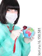 Купить «Doctor listening to a mini-globe's heartbeat», фото № 6150581, снято 2 апреля 2010 г. (c) Phovoir Images / Фотобанк Лори